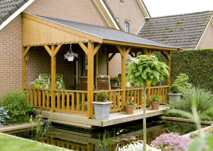 Веранда к деревянному дому построеная своими руками